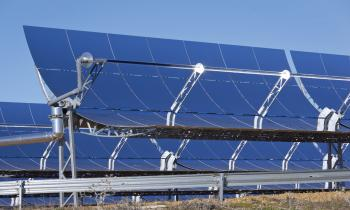 Sunlight making contact with a parabolic trough