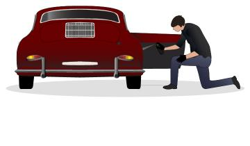 Classic vehicle owner lubricating Porsche 356 with lubricant in preparation for winter storage.