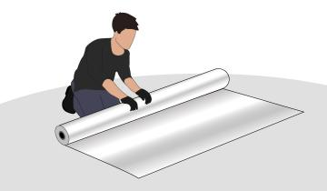 Vehicle owner rolling out plastic sheet on the floor for vehicle to park on while stored for the winter.