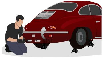 Porsche 356 owner putting wool ball in exhaust pipe to prevent critters from entering the tailpipe while the vehicle is stored for the winter.
